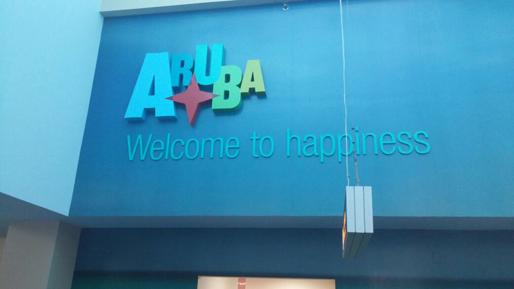 2-welcome to aruba sign on the airport